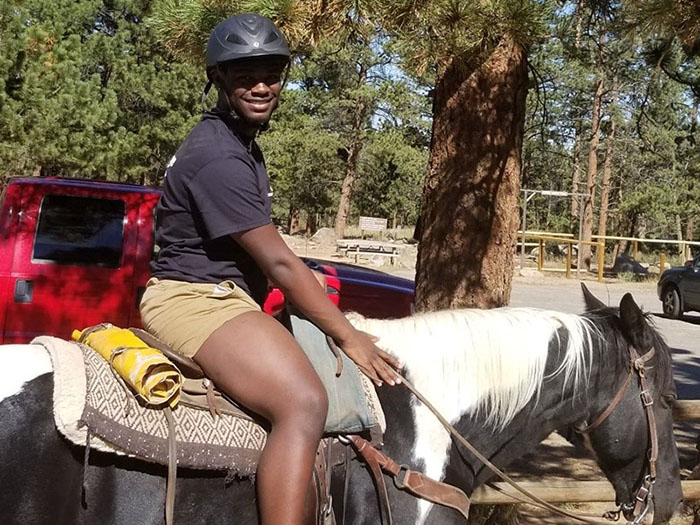 Rite of Passage Retreat Attendee on horse